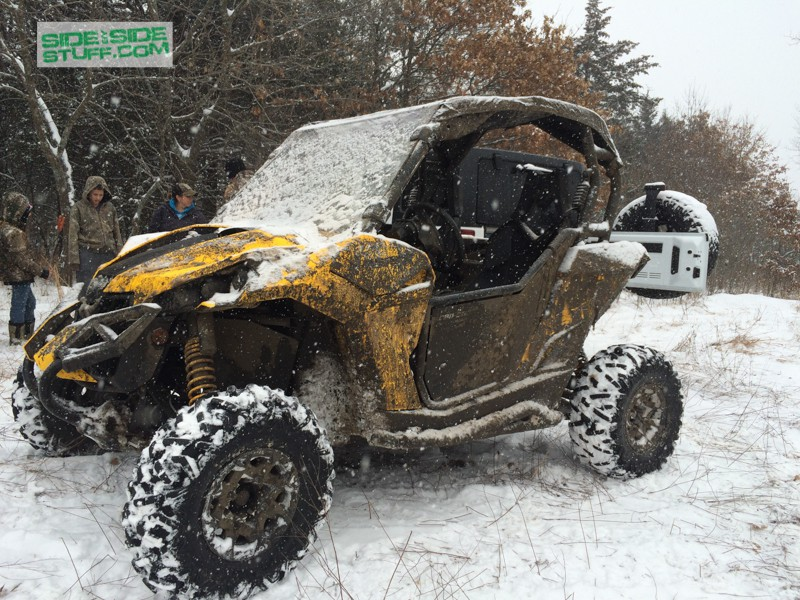 Can Am Maverick in snow, with windshield